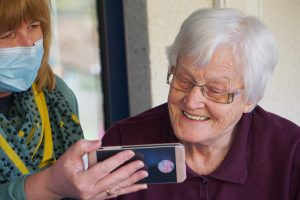 Care home resident communicating via video call
