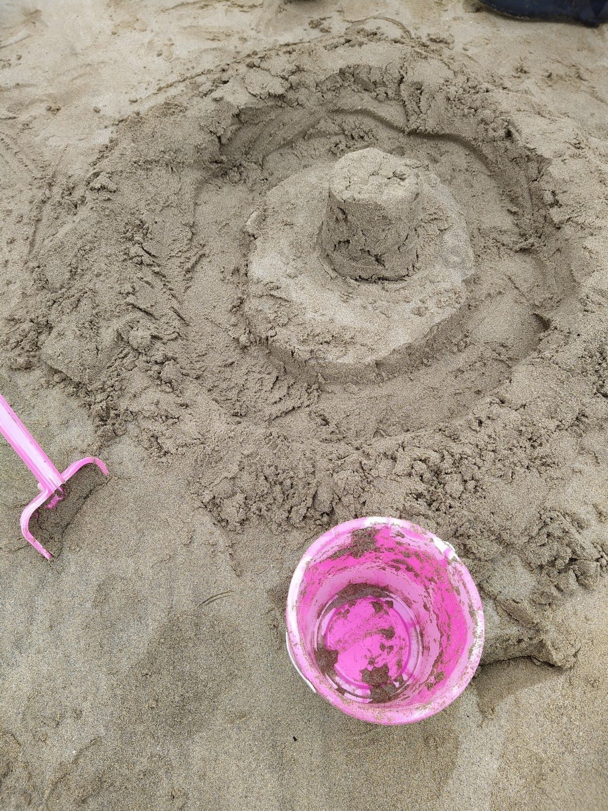 bucket and spade on sand